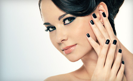Thirty-minute manicure coats nails in Shellac or Gelish polish that