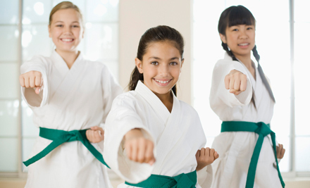 Students aged 4 to adult master basic self-defense skills in an encouraging ...