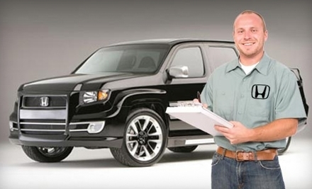 Sam pack auto group farmers branch tx groupon for Lute riley honda service