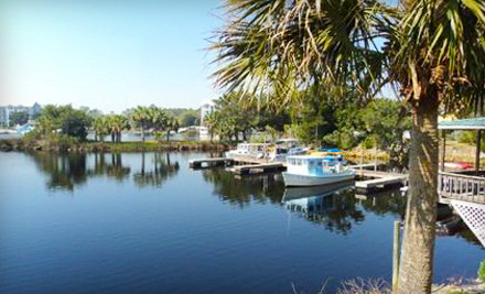 Half-Day Boat Rental and 1-Night Stay for Two People in Cabin 4 or 5 (a $200 value) - Shelter Cove Marina in Steinhatchee