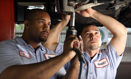 1-Year Package of Standard Oil Changes and Tire Rotations  (a $140 value) - Duxler Complete Auto Care in Evanston