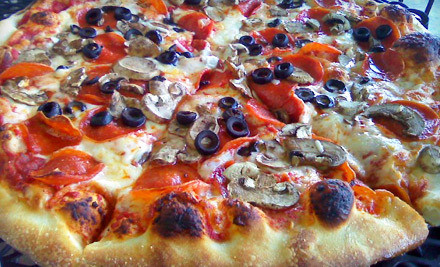 Salad (up to $8), 18-Inch Pizza with One Topping (up to $18) and Four Soft Drinks (up to $4) - Mamma Mia in Phoenix