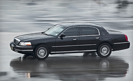1-Way Chauffeur Service to Logan International Airport in a Sedan (a $120 value) - Border Limousine Service in
