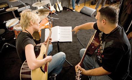Four 30-Minute Music Lessons (a $119 value) at 24961 Pico Canyon Rd., Stevenson Ranch - Guitar Center Studios in Woodland Hills