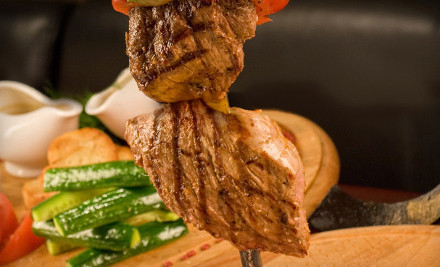 $50 Groupon, Valid for Groups of 2 or More - Brazilian Steakhouse in Woburn